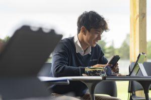 student smiling at desk