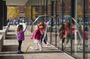 students playing with ribbons outdoors