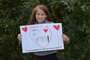 "student holding sign ""I love HPDS"""